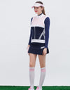 Women's knitted vest with stand collar, in pink and navy color blocking.
