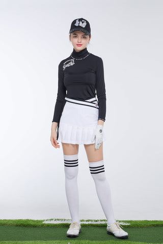 Women's A-Line skirt with pleated hem, in white and black color blocking, and wrapped waist.