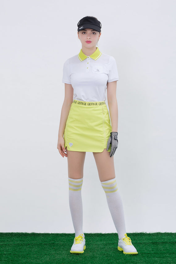 Women's short sleeve polo, in white, mesh sides and shoulder.