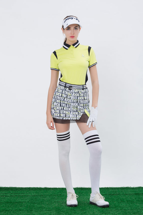 Women's short sleeve polo, in yellow, with black color blocking on both sides.
