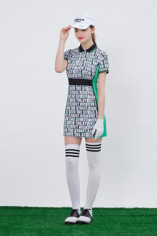 Women's mid-length golf dress with green slimming sides, white and black letter print, mesh waist band.