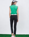 Women's sleeveless top, in green, with balck and white trims on shoulder and sleeves.