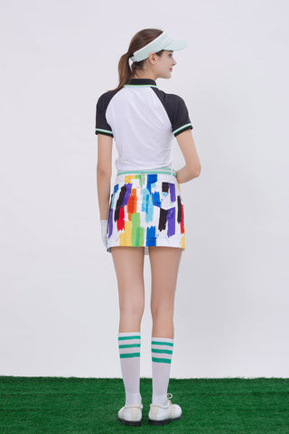 Women's white short sleeve polo, with green stripe trims, black contrasting sleeves