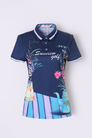 Women's short sleeve polo, in navy, with hand-painted floral print, and striped hem.