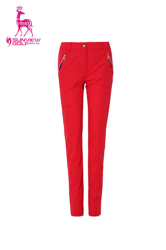 Women's slim pants with zipped pockets, in red.