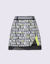 Women's A-Line skirt, with mesh lining, yellow color insert, and letter print.