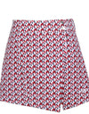 Women's A-line skirt, with red and navy geo print, in white.