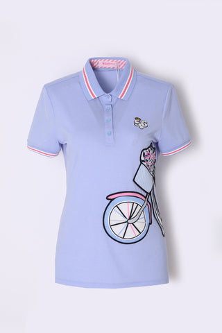 Women's blue short sleeve polo, with bicycle decorational patch.