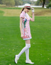 Women's mid-length cheongsam, in white and pink color blocking, with peacock print.