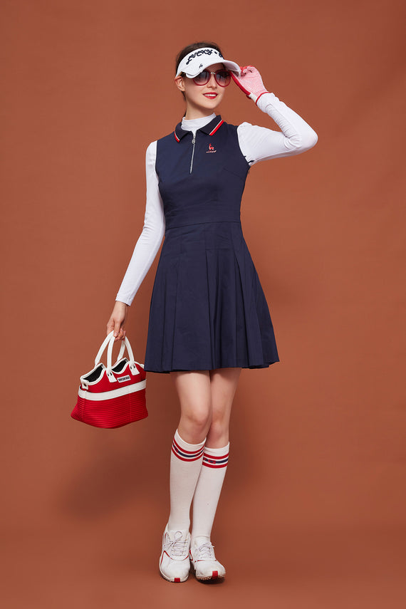 Women's navy sleeveless dress with zipped polo neck, pleat bottom.