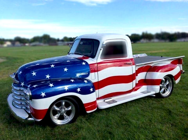 Classic Chevy truck with American Flag paint job.