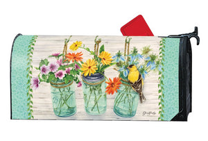 MailWrap with 3 mason jars full of wildflowers and a goldfinch perched on one of the vases
