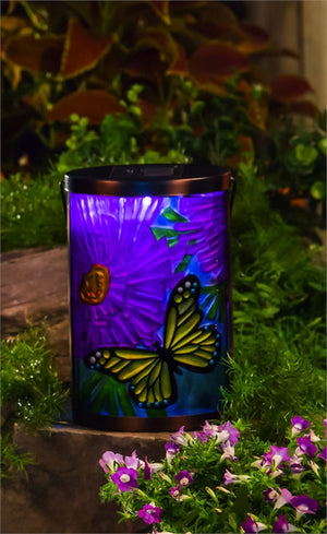 Garden Friends Butterfly Solar Lantern lit up at night