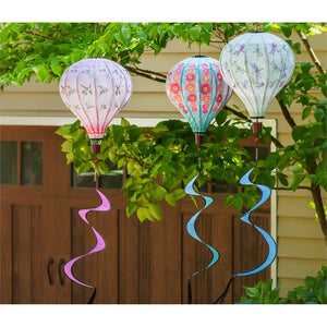 Hummingbirds Balloon Spinner with other spinners hanging in yard