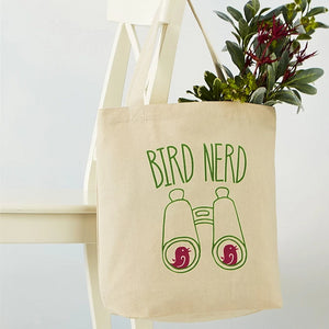 "Cotton tote bag that reads ""Bird Nerd"" and features an image of binoculars"