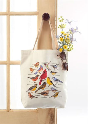 Bird Study Cotton Tote Bag with a variety of colorful birds illustrated on front of it hanging from doorknob full of a bouquet of flowers from the Farmer's Market