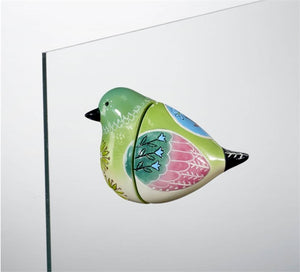 Bird Song Collection Hummingbird Screen Magnet displayed on glass window