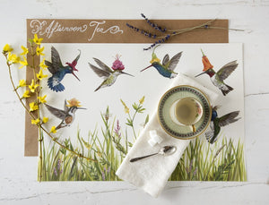 Meadow Buzz Hummingbirds Paper Placemats displayed on a dinner tabletop