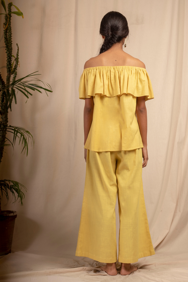 Sui | DAL PORTO embroidered, herbal-dyed handwoven organic cotton off-shoulder ruffled top from Granita Summer Collection 2019