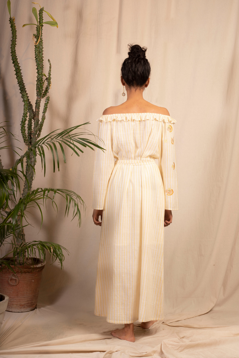 Sui | DOLCE VITA embroidered handwoven organic cotton off-shoulder maxi dress with a cinched waist from Granita Summer Collection 2019