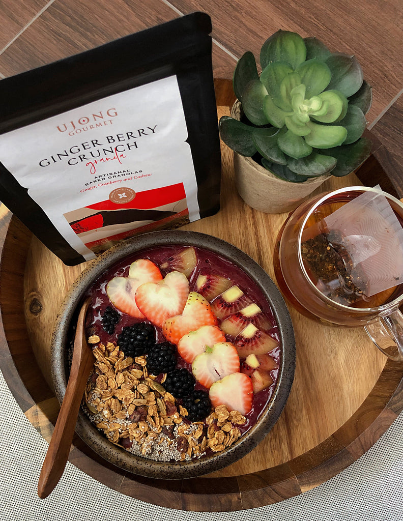 Super Berry Smoothie Bowl served with Ujong granolas and fruits, paired with a cup of Gryphon tea