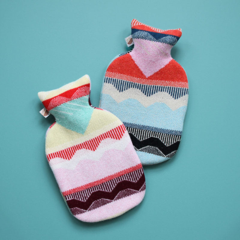 Colourful, patterned hot water bottles made from wool