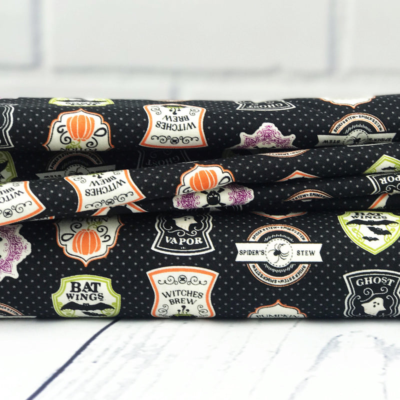 Black Badge Fabric from Eek Boo Shriek Collection at Cherry Creek Fabric
