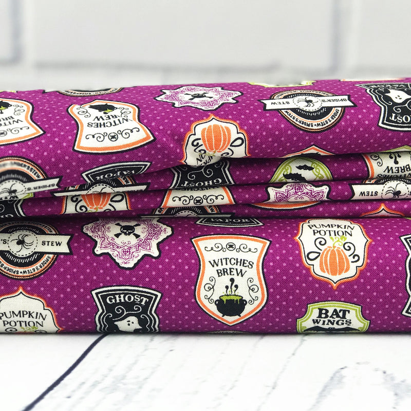 Purple Badge Fabric from Eek Boo Shriek Collection at Cherry Creek Fabric