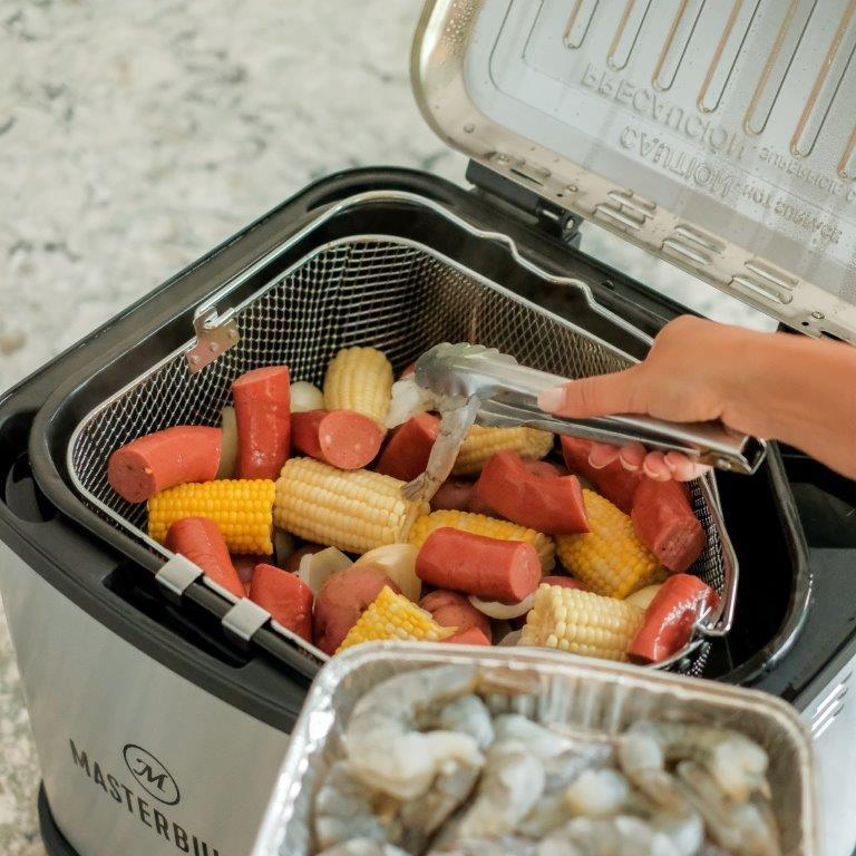 Masterbuilt® 10.6 Quart XL Electric  Fryer, Boiler, Steamer in Silver preparing for low country boil lid open