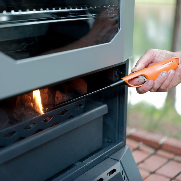 Bottom door of charcoal smoker opens for easy access to the firebox