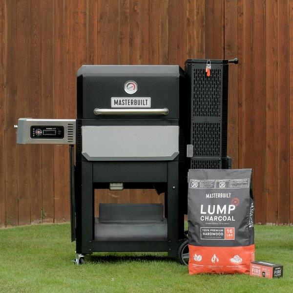 Gravity Series Grill with bag of lump charcoal and box of firestarters