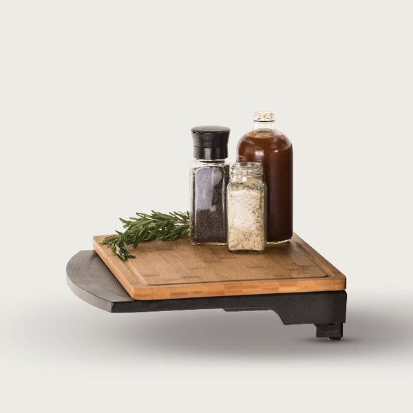 Side shelf holding cutting board and condiments