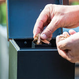 Scroll to product image Loading wood chips into the slow smoker