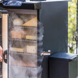 Scroll to product image 4 racks of cheese and fish in a smoker with the slow smoker attached