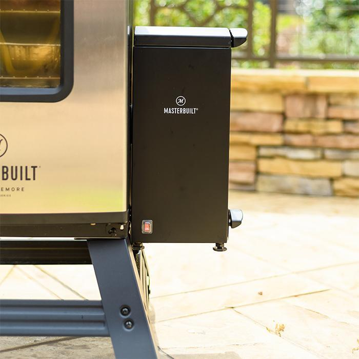 Close-up of the slow smoker attached to electric smoker through the wood chip loader slot
