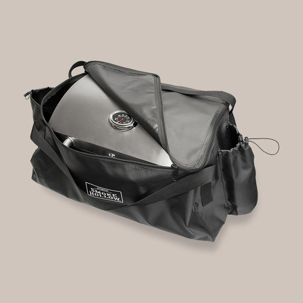 Tabletop grill fits snugly into carry bag. Zipper around top secures the grill inside. Has 2 carry straps and 2 side pockets sized to hold small propane tanks