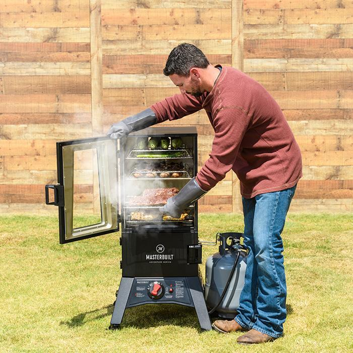 Masterbuilt 30 in Thermotemp propane smoker  zoomed out open smoking food view