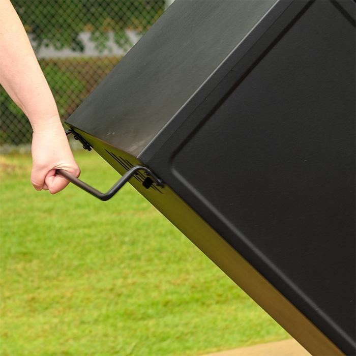 Masterbuilt Pro Series Dual Fuel Smoker in Black using handle to show ease of moving the product