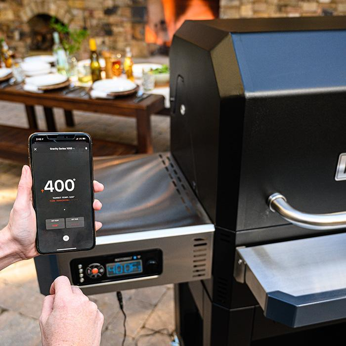 Using the Masterbuilt App on a smartphone to monitor cooking temperature