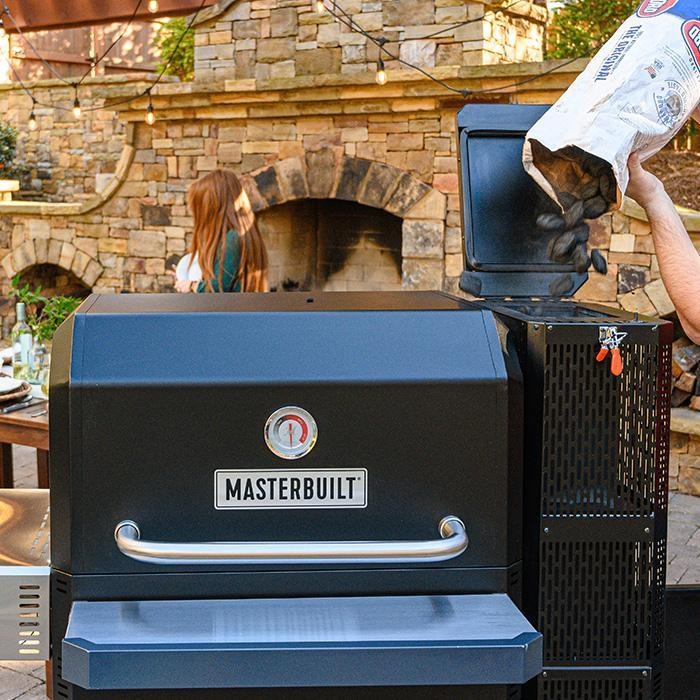 Masterbuilt Gravity Series 1050 grill adding charcoal to the hopper