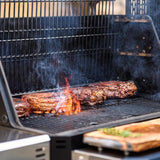 Scroll to product image Grilling steaks on the Masterbuilt Gravity Series 1050 with the FoldAway racks tucked out of the way