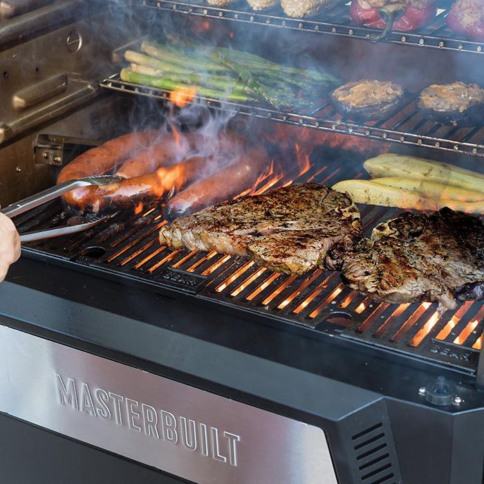 Grill and sear on the lower grate while you grill tender vegetables on the upper grates