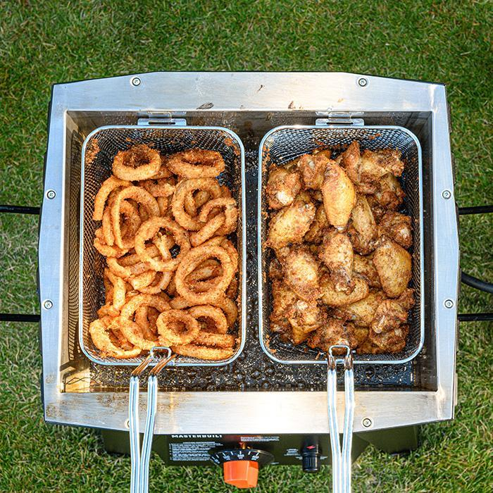 Fry fish and chips or wings and rings using 2 smaller baskets to keep foods separate