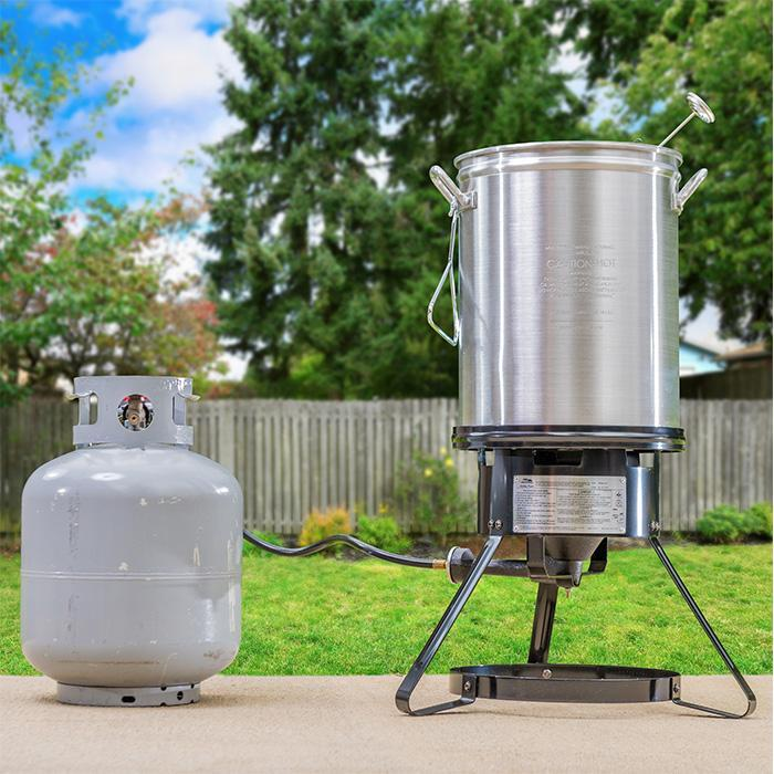 Assembled fryer on stand with propane tank attached