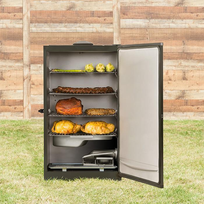 Masterbuilt MES 140|B Digital Electric Smoker, open, with ribs, chicken, vegetables and more smoked and ready to eat