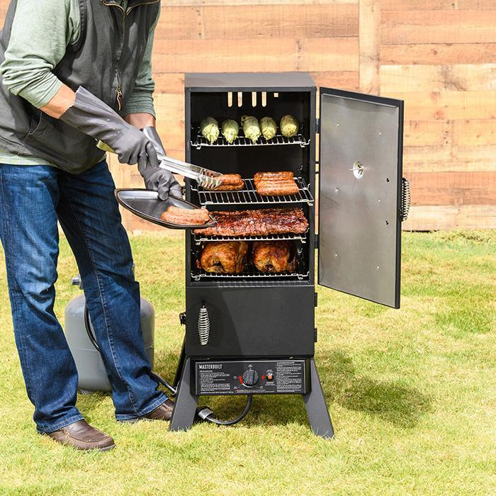 Masterbuilt 30 in propane smoker open door taking off smoked food image