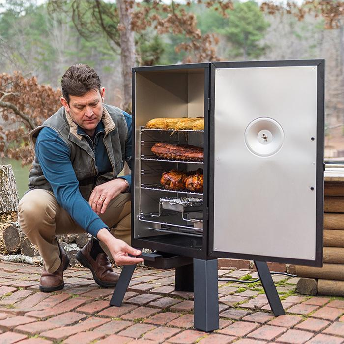 "30"" Masterbuilt Analog Electric Smoker, open, smoking ribs, chicken and corn. Demonstrating easy removal of drip cup."