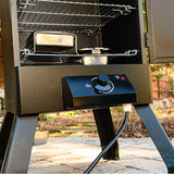 Scroll to product image Control knob, chip tray, and water pan in the Analog Electric Smoker