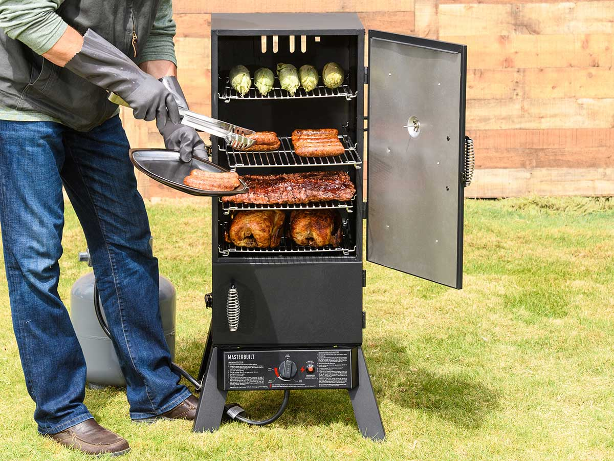 Masterbuilt Pro Series Dual Fuel Smoker in Black food on 4 chrome racks