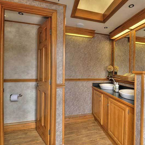 platinum restroom trailer with wood and marbled walls